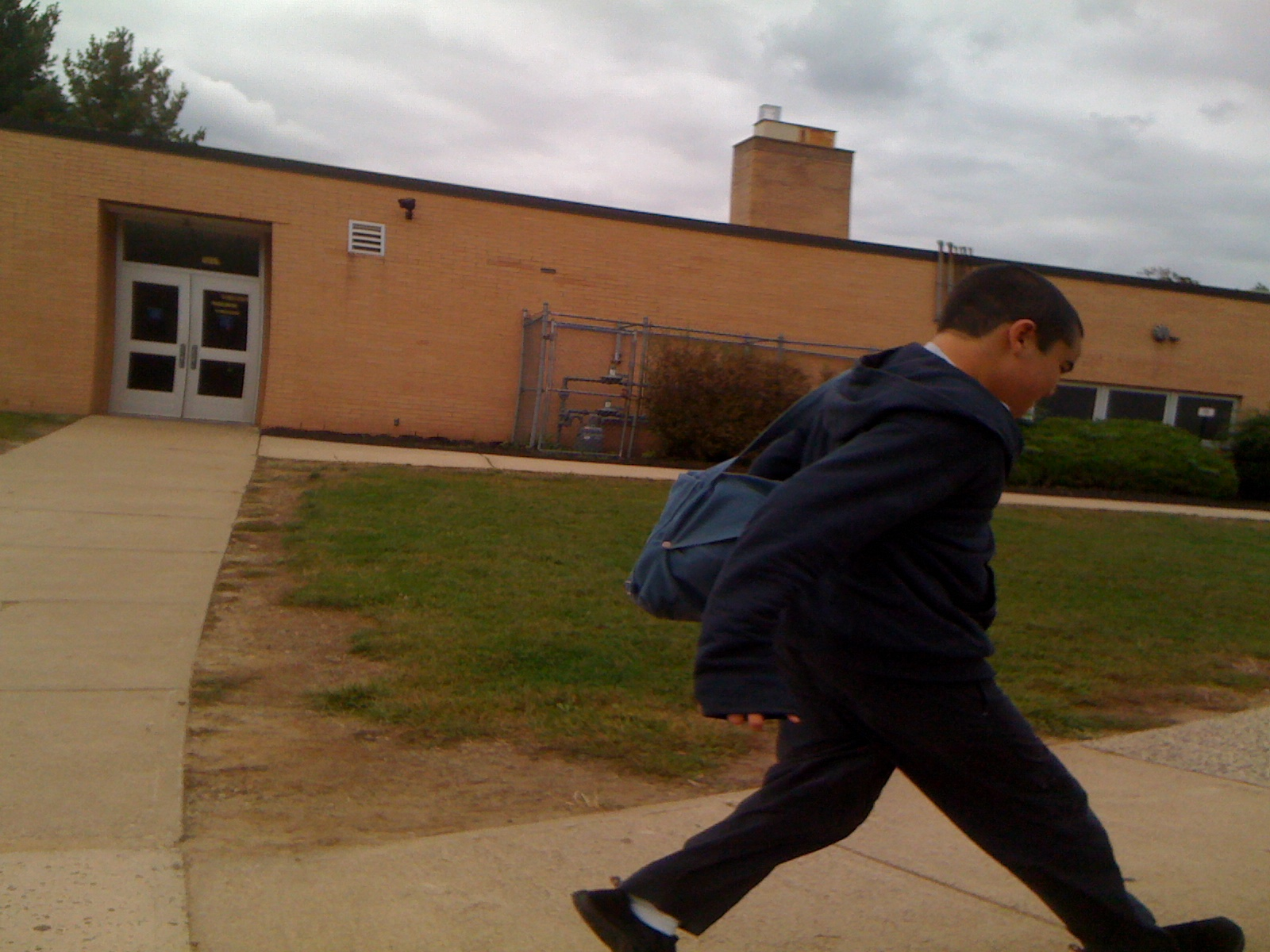Charlie walking to the car past the middle school