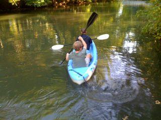 Jim and Charlie paddle away