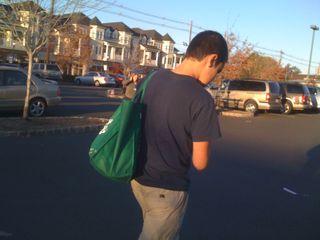 Charlie shoulders the groceries