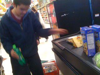 Charlie loading groceries onto the conveyor belt at ShopRite