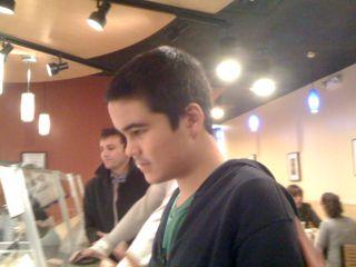 Charlie waiting for a burrito at Qdoba