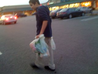 Charlie carrying all three bags of groceries