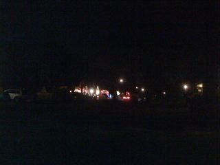 A neighbor's Christmas lights seen from a distance