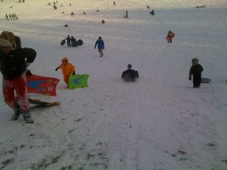 Jim on the sled, Charlie on the slope