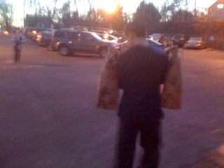 Charlie carrying two heavy grocery bags
