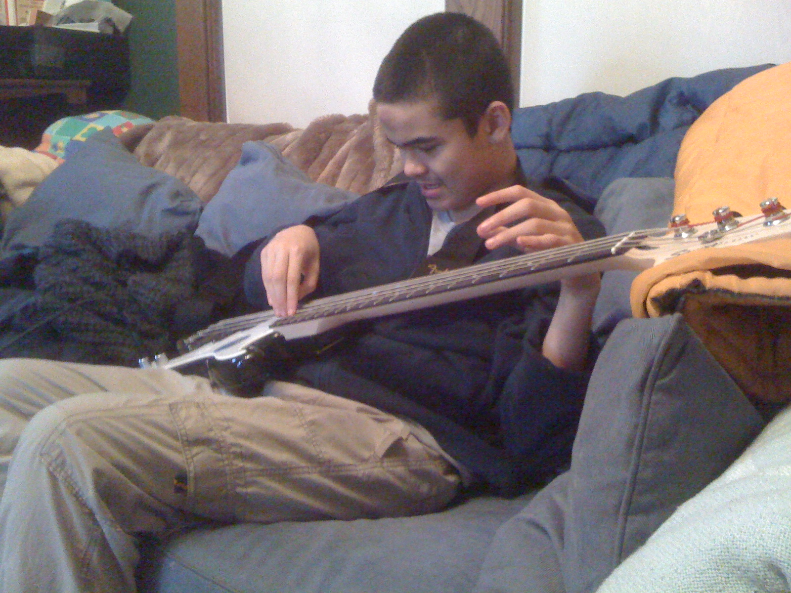 Charlie strumming his new bass guitar