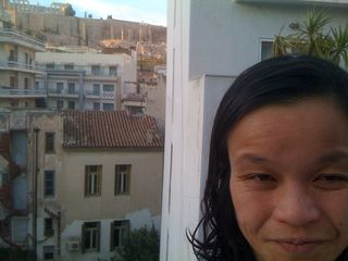 Me in my hotel room, Acropolis behind me