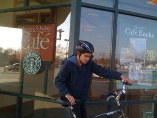 Charlie leaving Barnes & Noble on his bike