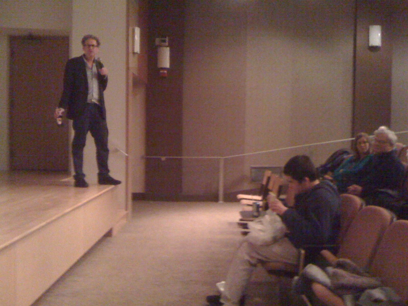 Jim speaking at Saint Peter's College, Charlie in the front row