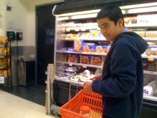 Charlie carrying a shopping basket at ShopRite