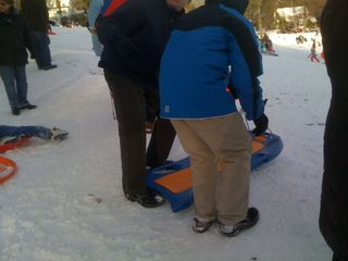 Jim helping Charlie get on the sled
