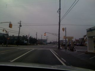 Street signals flashing yellow down the shore