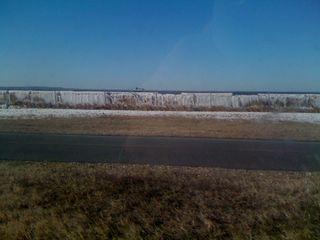 Ocean water frozen on a wire fence