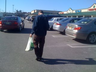 Charlie carrying groceries to the car on a sunny, cold Sunday