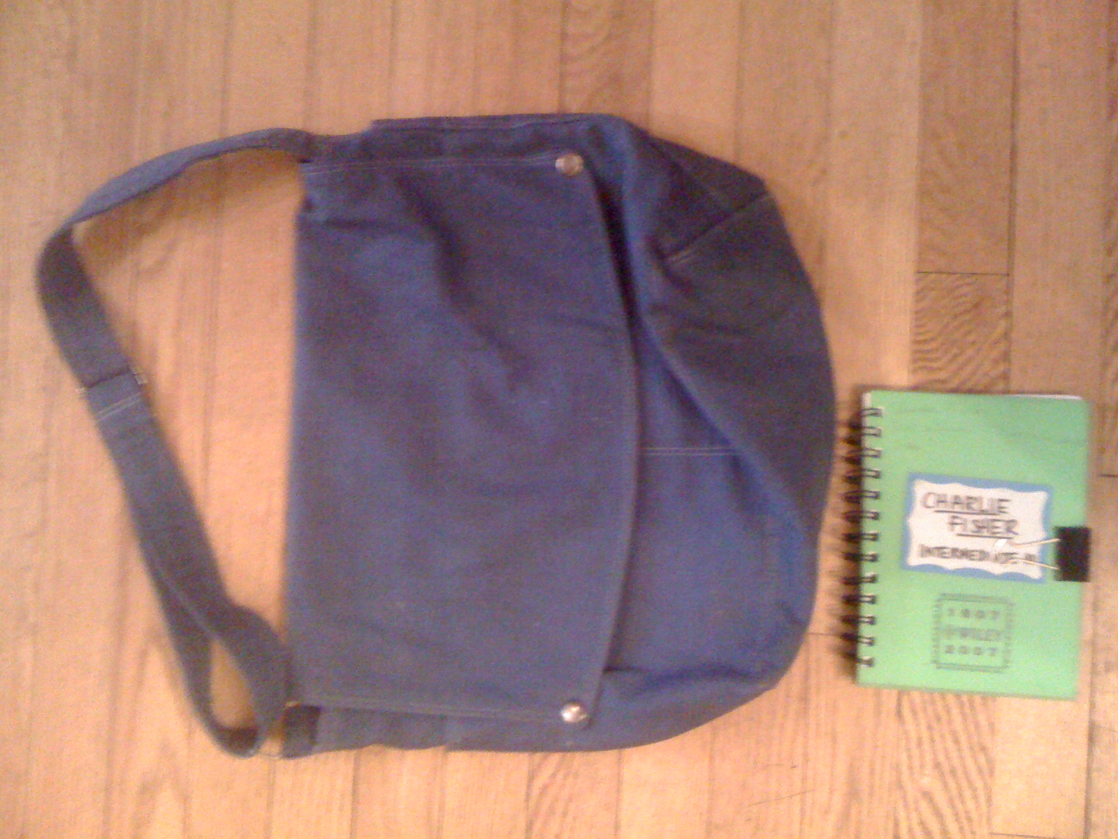Arrangement with bookbag and notebook by Charlie