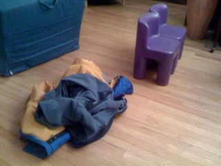 Arrangement of coats and purple chairs by Charlie