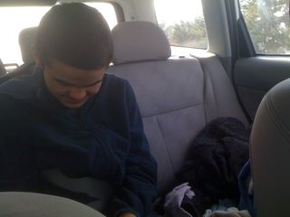 Charlie in the back seat of the white car on the way to the beach in late February