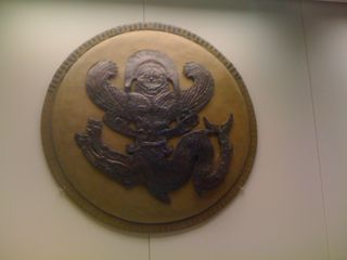 Shield in the museum at ancient Olympia, with Medusa the Gorgon