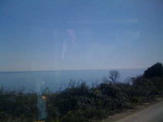 Fleeting view of the Aegean Sea from the bus window