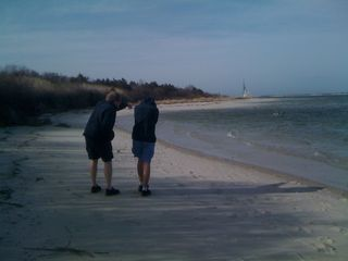 Jim and Charlie walking on a windy beach