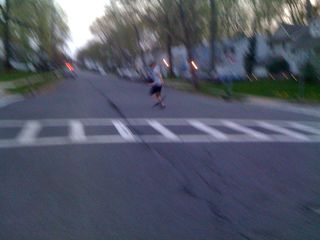 Charlie running across the street (after checking for traffic)