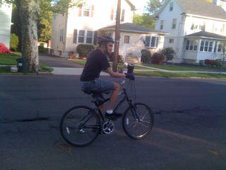 Charlie riding his bike