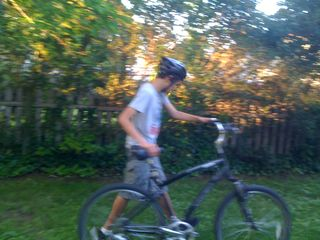Charlie taking his bike through the back yard for a bike ride