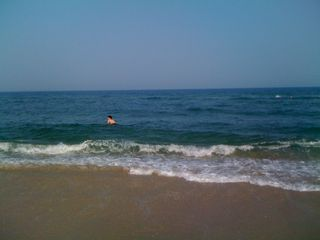 Charlie boogie boarding in the ocean on Memorial Day MMX