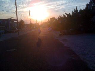 Charlie leaving the beach as the sun sets