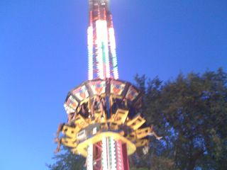 Charlie riding a really tall Frog Hopperish ride (can you see him?)