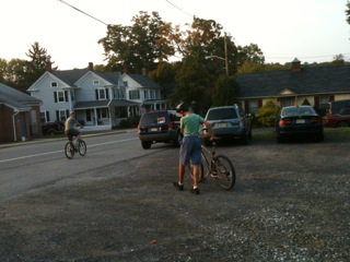 Charlie and Jim getting ready to bike on the road by the river