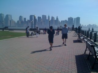 Charlie and Jim walking with the skyline of lower Manhattan behind