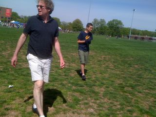 Jim and Charlie walking on a field at Rutgers University