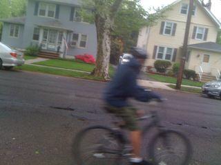 He bikes so fast he's a blur!
