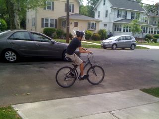 Charlie on the move, riding his bike on a May Saturday