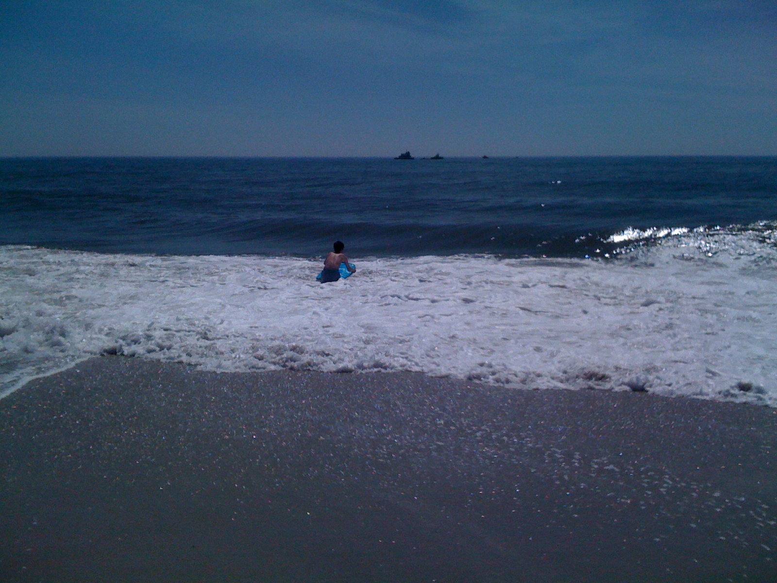 Out to the ocean, boy and board