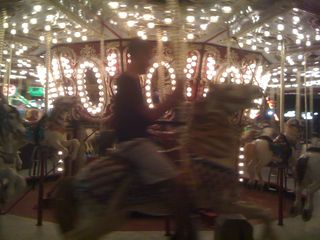 First time Charlie got himself onto a merry-go-round horse all by himself