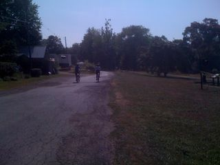 Jim and Charlie going for a bike ride in lovely, shady country