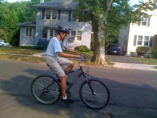 Charlie riding his bike on a 96 degree day (that's cool after Tuesday's extreme heat!)