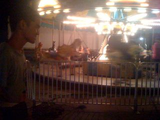 Charlie, all smiles, waiting to ride the merry-go-round just before the firemen's carnival closed