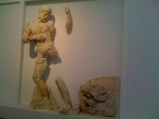 Fragments of a frieze of Herakles and the Nemean Lion in the museum in Archaic Olympia