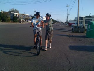 Jim cheering on Charlie after riding 18 miles, the full length of our beach
