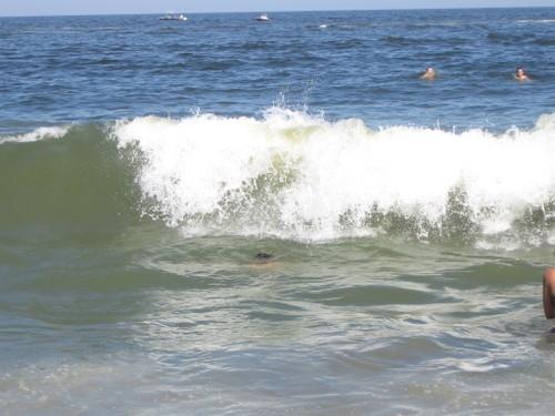 Charlie ducks under a wave